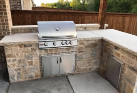 sawn lueders slabs used as a countertop for this outdoor kitchen done by rockwall stone design