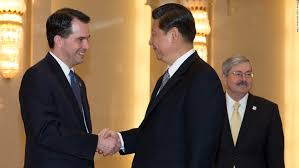 Scott Walker (left) shakes hands with Chinese President Xi Jinping (center)  before