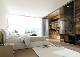 closet behind bed walk in closet under bed home design ideas bedroom closet doors houzz