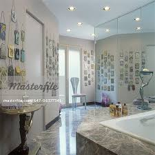 collection displays a metal mesh vintage purse collection on wall in master bathroom brown