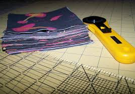 Quilting Accessories: Your Favorite Mats, Rulers and Rotary Cutters & Cutter and Fabric Stack on Gridded Surface Adamdwight.com