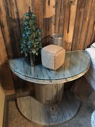 wooden electrical spool table turned into a bedside nightstand a rh avisiontoremember com wood spool chairs wood spool table plans