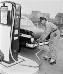 tire inflator gas station. gas station attendant on rollerskates, 1957. tire inflator c