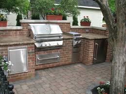 ... Custom brick outdoor kitchen and bar with precast limestone pergola  design Saddle River NJ ...