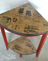 Table top and bottom shelf decoupaged with a shopping bag