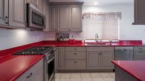 Inspiring red quartz countertop with black stove