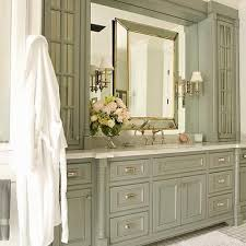 bathroom features gray shaker vanity: traditional gray bathroom features gray shaker vanity cabinets paired with white quartz countertops under an inset mirror lit by glass sconces flanked by