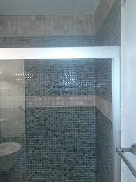 simple shower decor with glass mosaic wall panel accent combined with rectangle white stained
