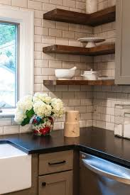 black kitchen countertops crisply contrast a white subway tile backsplash for a look that s fresh and