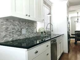 dark granite countertops with white cabinets this impressive kitchen