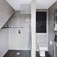 Grey bathroom with floor-to-ceiling tiles