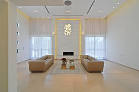 lighting for tall ceilings. tall ceiling with pendant lamp beige leather lounge sofa regtangular fabric pattern rug ceramic tile lighting for ceilings