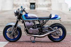 now keith is back with yet another two stroke street smoker a suzuki gt380 cafe racer built for his annual trip to the tail of the dragon