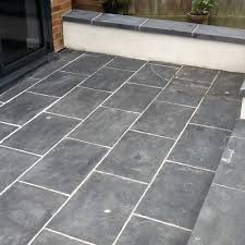 patio slate tiles with grout haze before cleaning brackley