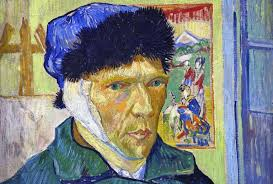 face of van gogh wearing a blue cap and a bandage over his ear