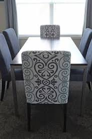i turned a beautiful printed tablecloth into a custom dining room chair slipcover to makover bare henriksdal chairs from ikea