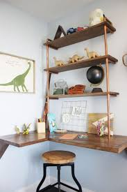 medium size of a floating desk with pipe shelves tucked into the corner is the a