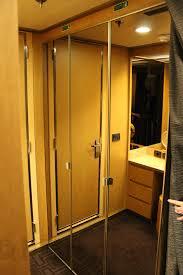splendiferous swing mirrored closet doors added vanities with drawer in small room decorating inspirations