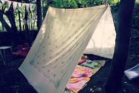 a sheet on the ground, some blankets and cuddly toys and this is the  perfect kiddo hideaway