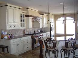 White Stained Wood Kitchen Cabinets This Creamy Colored Kitchen Gets Drama From The Dark Wood Beams