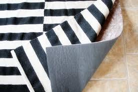 choosing a rug pad for tile floors by craftivityd sunroom family room
