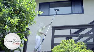 how to wash high windows without using a ladder and clean rain gutters easily on your house