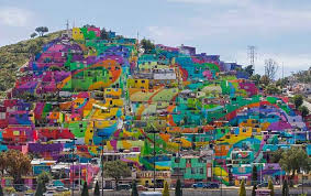 Hundreds of houses painted in bright colors in what organizers claim is  Mexico's largest mural,