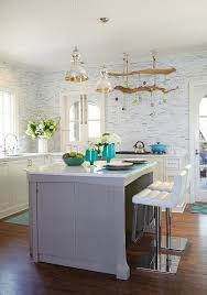 whimsical kitchen features a pair of jamie young st charles mercury glass pendants illuminating a gray center island topped with curved marble lined with
