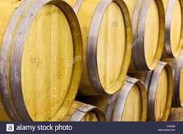 Close up of Oak wine barrels in a wine cellar Stock Photo Royalty