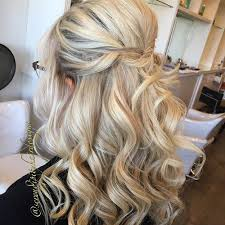 hairstyles for wedding guest. curly formal half updo with a bouffant hairstyles for wedding guest