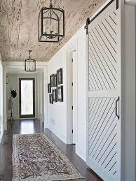 create a stylish entryway by following these four steps 1 bold accents 2 go rustic 3 add a barn door and 4 create a kid zone