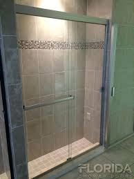 best frameless shower doors sliding door brushed nickel with a pound on handle and towel bar glass