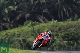jorge lorenzo and his ducati gp18 were clearly the fastest bike and rider at sweltering hot sepang today the spaniard bettering repsol honda s dani pedrosa