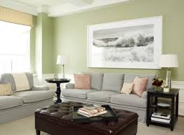 very light grey sofas and green walls look cozy and family friendly