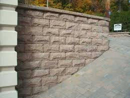 sloped driveway with custom retaining wall walls rochester minnesota