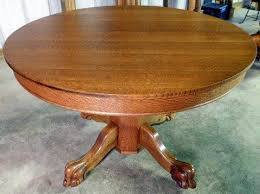 45 round tiger oak table with 5 original 9 leaves unusual octagonal base with carved claw feet extends to 89 1 4