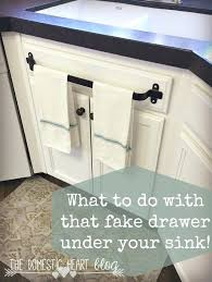 should you tile under your kitchen cabinets an error occurred tile paint on kitchen cupboards