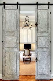 Traditional Home Office with Built-in bookshelf, Barn door, Hanging rustic  door,