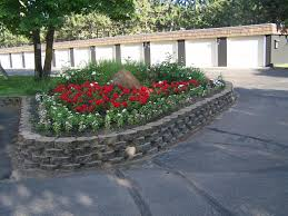 Decorative Stones For Flower Beds Tough Stone Raised Flower Bed Colorful Flowers Paved Shady Trees