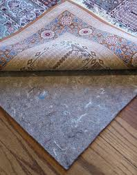 colossal non slip rug pads for hardwood floors floor design area light liner rugs how to keep in place mat laminate flooring where polymer coated