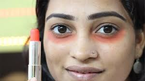 makeup hack this is how i cover dark under eye circles using orange lipstick