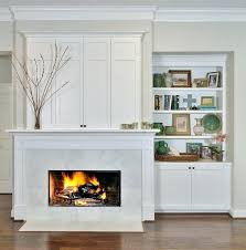tv cabinet over fireplace after fireplace wall remodel with above in cabinetry with bi fold doors tv cabinet over fireplace