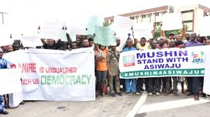 Image result for Mushin, Odi-Olowo APC members want Banire suspended