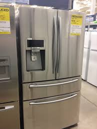 samsung refrigerator 4 door. a samsung 4-door french door refrigerator with an external ice dispenser. this is grown up fridge, it could not possibly be in our price range. 4
