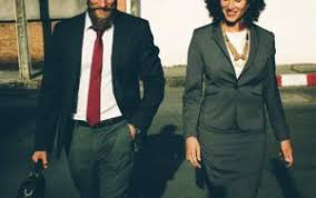 office space pics. A Man And Woman Dressed In Business Wear Walk Down The Street Side By Office Space Pics