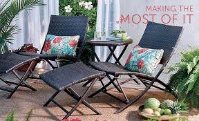 small outdoor living space with wicker outdoor furniture