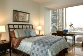 how to decorate furniture. Light-colored Walls And Bedding Produce A Pleasant Contrast Against Furniture In Medium Cherry How To Decorate