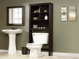 Black Over The Toilet Cabinet White Porcelain Pedestal Washbasin Beside Black Wooden Without
