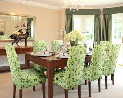 lovely gray parsons chairs with leaves motif and brown wooden legs plus brown wooden dining table