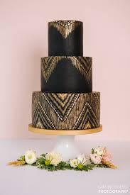sleek black and gold cake